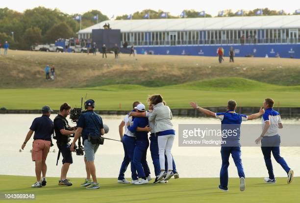 Alex Noren of Europe celebrates winning his match on the 18th green as Europe win The Ryder Cup during singles matches of the 2018 Ryder Cup at Le...