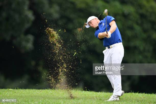 Alex Noren of Europe hits an approach shot on the 15th hole during the singles matches on day three of the 2018 EurAsia Cup presented by DRBHICOM at...