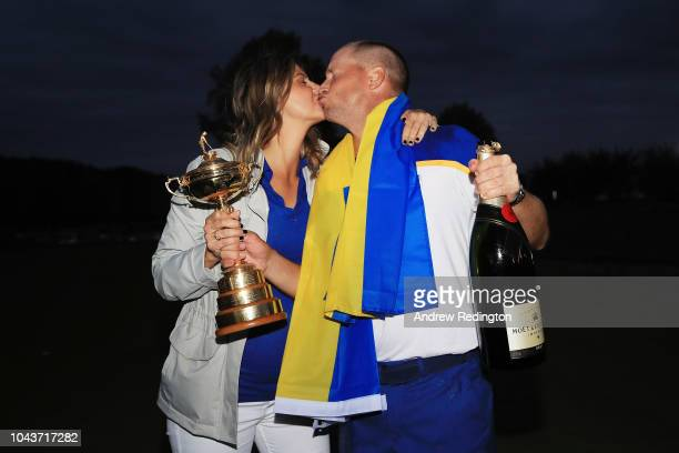 Alex Noren of Europe shares a kiss with wife Jennifer Noren following Europes win in the Ryder Cup following the singles matches of the 2018 Ryder...