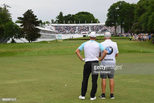 Alex Noren of Sweden and his caddie Jamie Warne on the 18th hole during day four of the BMW PGA Championship at Wentworth on May 28 2017 in Virginia...