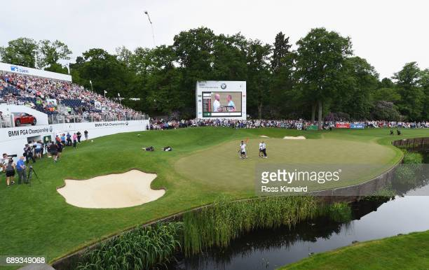 Alex Noren of Sweden and his caddie Jamie Warne shake hands on the 18th green during day four of the BMW PGA Championship at Wentworth on May 28 2017...