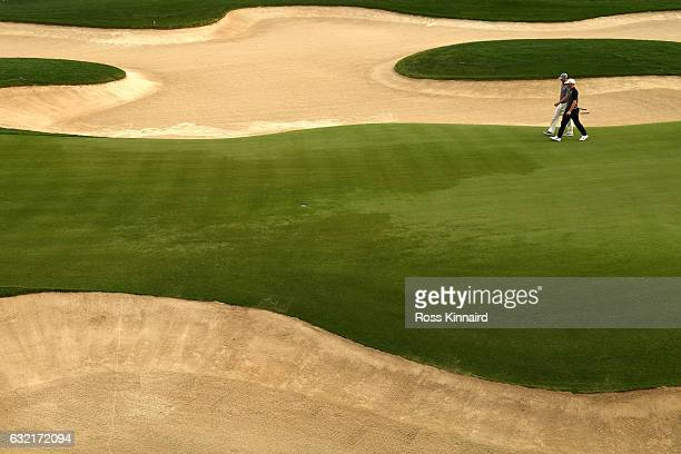 Alex Noren of Sweden and Martin Kaymer of Germany walk onto the 18th green during the second round of the Abu Dhabi HSBC Championship at the Abu...