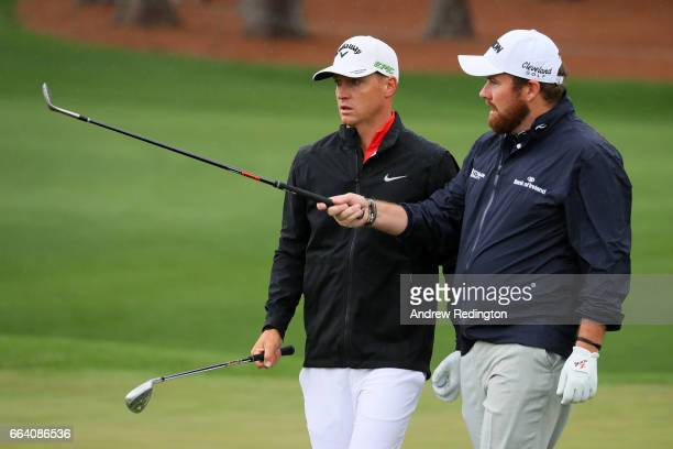 Alex Noren of Sweden and Shane Lowry of Ireland talk on the second hole during a practice round prior to the start of the 2017 Masters Tournament at...