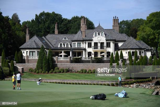 Alex Noren of Sweden and Tommy Fleetwood of England prepares to putt on the seventh green during the final round of the 2017 PGA Championship at...