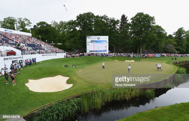 Alex Noren of Sweden celebrates an eagle on the 18th green for a round of 62 during day four of the BMW PGA Championship at Wentworth on May 28 2017...
