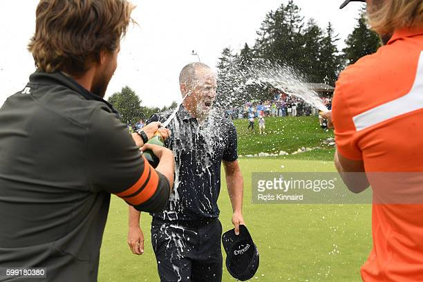 Alex Noren of Sweden celebrates victory after sinking a long putt on the the first extra hole during the final round of the Omega European Masters at...