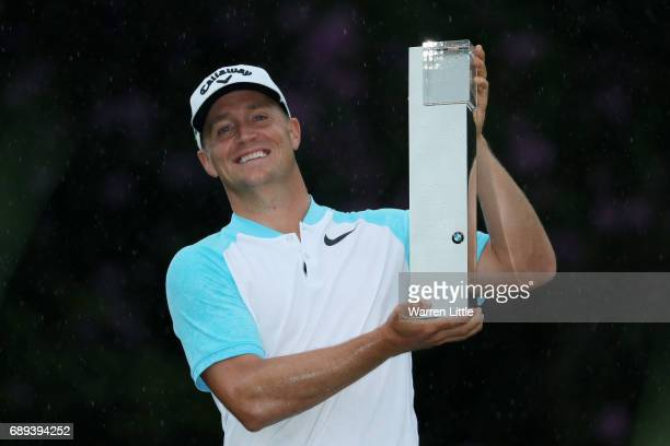 Alex Noren of Sweden celebrates victory with the trophy after the final round on day four of the BMW PGA Championship at Wentworth on May 28 2017 in...