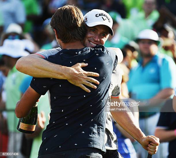 Alex Noren of Sweden celebrates winning with Joakim Lagergren of Sweden after the final round of The Nedbank Golf Challenge at Gary Player CC on...