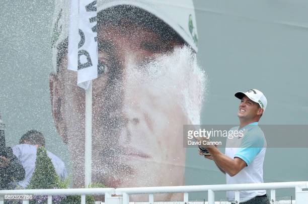 Alex Noren of Sweden celebrates with champagne after his win during the final round of the 2017 BMW PGA Championship on the West Course at Wentworth...