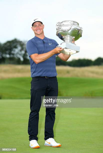 Alex Noren of Sweden celebrates with the trophy after winning the HNA Open de France at Le Golf National on July 1 2018 in Paris France