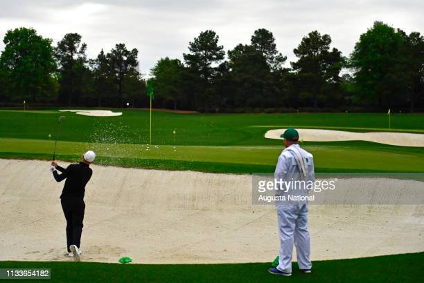 Alex Noren of Sweden hits a stroke out of a bunker on the Tournament Practice Facility during practice Round 3 at Augusta National Golf Club...