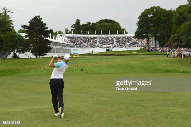 Alex Noren of Sweden hits his second shot into the 18th green during day four of the BMW PGA Championship at Wentworth on May 28, 2017 in Virginia...