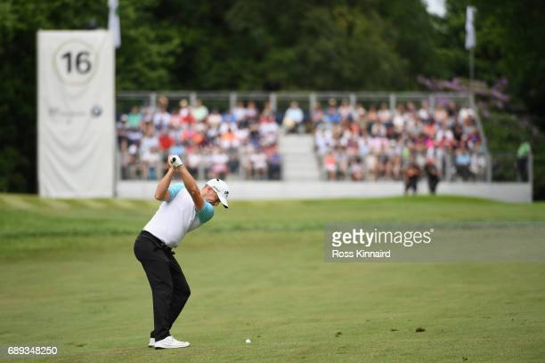 Alex Noren of Sweden hits his second shot on the 16th hole during day four of the BMW PGA Championship at Wentworth on May 28 2017 in Virginia Water...