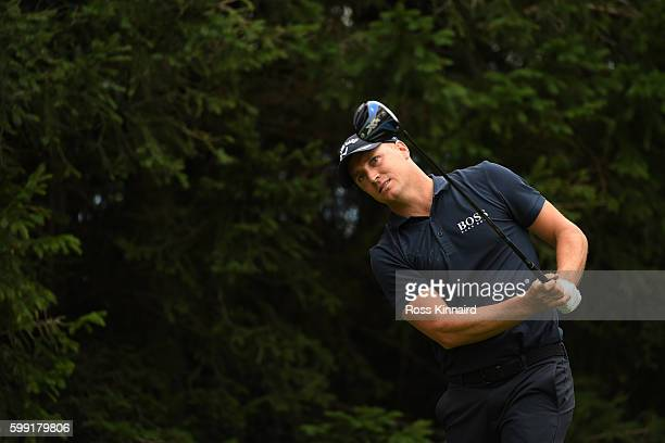 Alex Noren of Sweden hits his tee shot on the 15th hole during the final round of the Omega European Masters at CranssurSierre Golf Club on September...