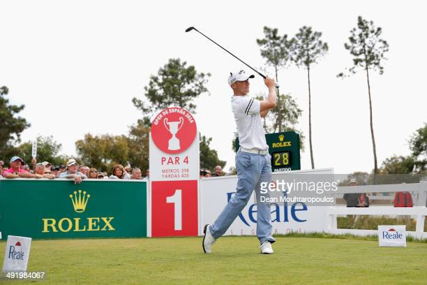 Alex Noren of Sweden hits his tee shot on the 1st hole during the final round of the Open de Espana held at PGA Catalunya Resort on May 18, 2014 in...