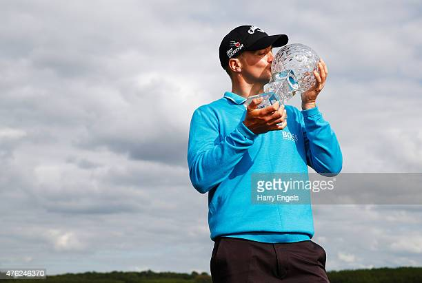 Alex Noren of Sweden kisses the trophy after his victory during day four of the Nordea Masters at PGA Sweden National on June 7 2015 in Malmo Sweden