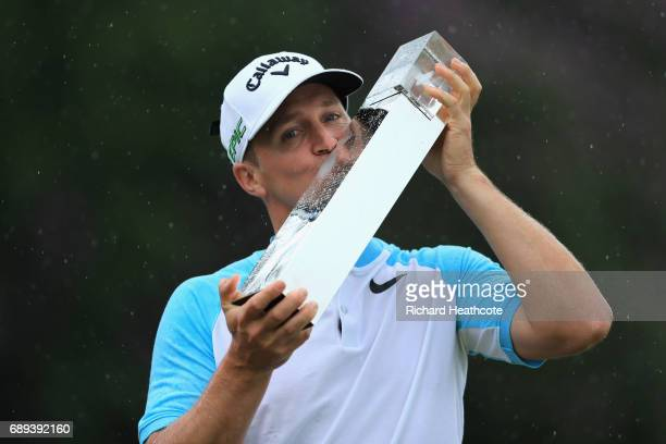 Alex Noren of Sweden kisses the trophy after winning the BMW PGA Championship at Wentworth on May 28 2017 in Virginia Water England