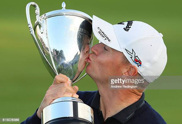 Alex Noren of Sweden kisses the trophy following his victory during the fourth round of the British Masters at The Grove on October 16 2016 in...