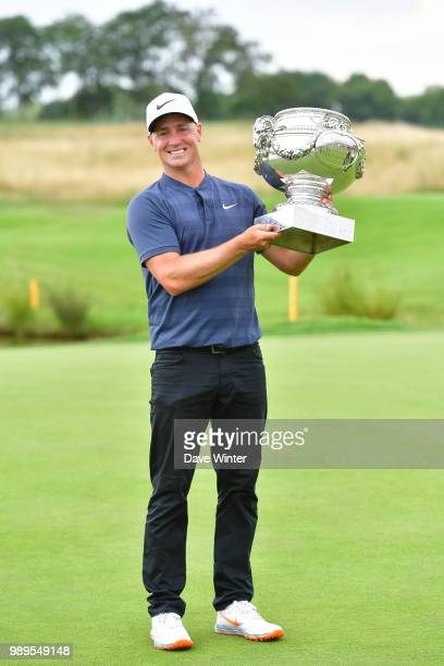 Alex NOREN of Sweden lifts the trophy after winning the HNA French Open on July 1 2018 in SaintQuentinenYvelines France