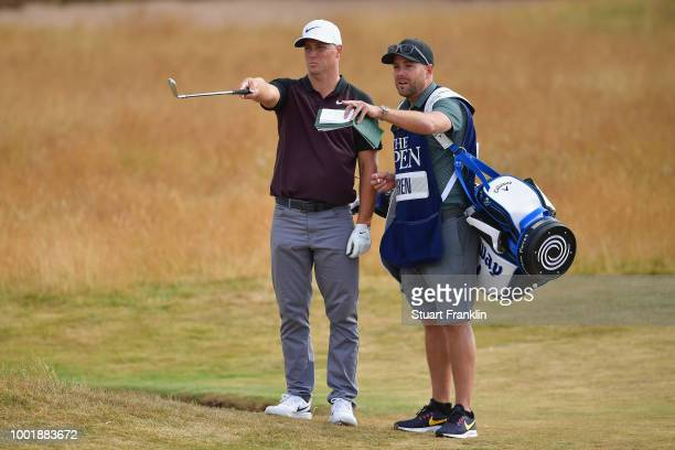 Alex Noren of Sweden looks on with his caddie during the first round of the 147th Open Championship at Carnoustie Golf Club on July 19 2018 in...