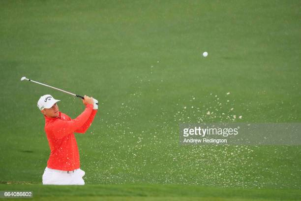 Alex Noren of Sweden plays a bunker shot during a practice round prior to the start of the 2017 Masters Tournament at Augusta National Golf Club on...