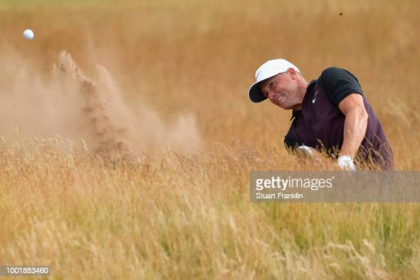 Alex Noren of Sweden plays a shot from a bunker on the 15th hole during the first round of the 147th Open Championship at Carnoustie Golf Club on...