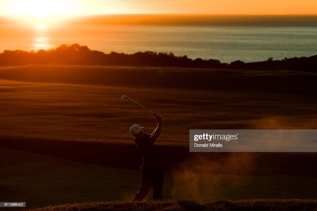 Alex Noren of Sweden plays a shot from a bunker on the 17th hole on the fourth playoff hole during the final round of the Farmers Insurance Open at Torrey Pines South on January 28, 2018 in San Diego, California.