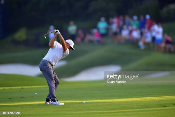 Alex Noren of Sweden plays a shot on the 12th hole during the second round of the 2018 PGA Championship at Bellerive Country Club on August 10 2018...