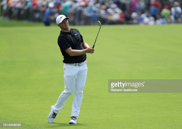 Alex Noren of Sweden plays a shot on the first hole during the first round of the 2018 PGA Championship at Bellerive Country Club on August 9 2018 in...