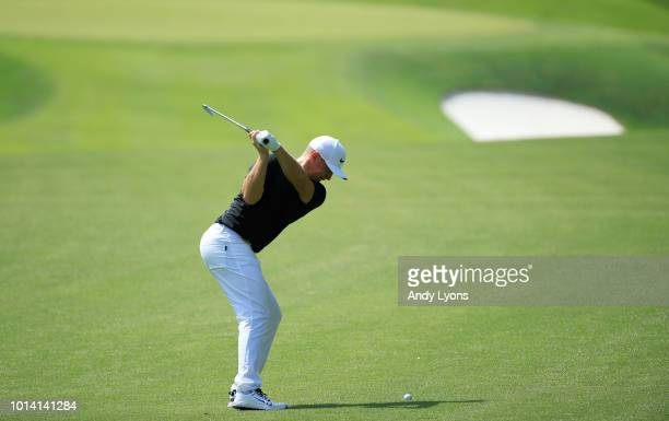 Alex Noren of Sweden plays a shot on the tenth hole during the first round of the 2018 PGA Championship at Bellerive Country Club on August 9 2018 in...