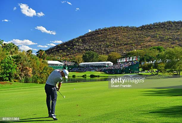 Alex Noren of Sweden plays his approach shot on the 18th hole during the final round of The Nedbank Golf Challenge at Gary Player CC on November 13...