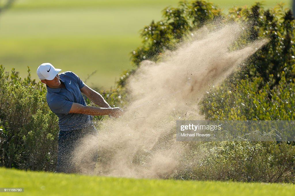 Alex Noren of Sweden plays his second shot from the bunker on the 14th hole during the third round of the Farmers Insurance Open at Torrey Pines South on January 27, 2018 in San Diego, California.