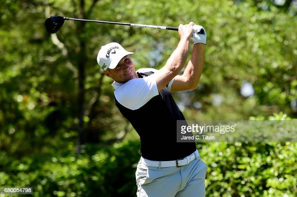 Alex Noren of Sweden plays his shot from the fourth tee during the final round of the Wells Fargo Championship at Eagle Point Golf Club on May 7 2017...