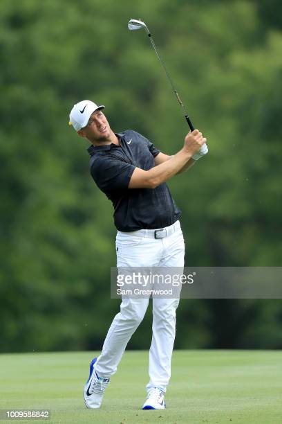 Alex Noren of Sweden plays his shot on the 11th hole during World Golf ChampionshipsBridgestone Invitational Round One at Firestone Country Club...