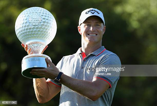 Alex Noren of Sweden poses with the trophy after his victory after the final round of the Nedbank Golf Challenge at the Gary Player CC on November 13...