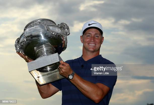 Alex Noren of Sweden poses with the trophy after winning the HNA Open de France at Le Golf National on July 1 2018 in Paris France