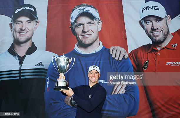 Alex Noren of Sweden poses with the trophy following his victory during the fourth round of the British Masters at The Grove on October 16 2016 in...