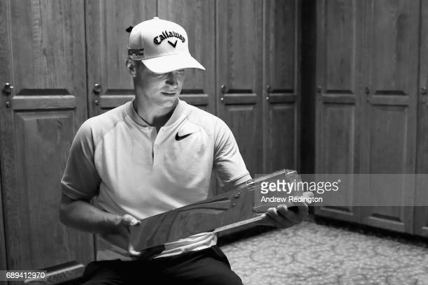 Alex Noren of Sweden poses with the trophy in the locker room after winning the BMW PGA Championship at Wentworth on May 28 2017 in Virginia Water...