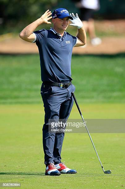Alex Noren of Sweden reacts to his second shot on teh par 4 ninth hole during the first round of the 2016 Omega Dubai Desert Classic on the Majlis...