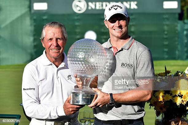 Alex Noren of Sweden receives the trophy from Gary Player after his victory during day four of the Nedbank Golf Challenge at Gary Player CC on...