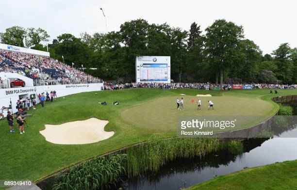 Alex Noren of Sweden shakes hands with Peter Uihlein of the United States on the 18th green during day four of the BMW PGA Championship at Wentworth...