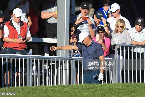 Alex Noren of Sweden takes a drop on the 18th hole during the final round of the Farmers Insurance Open at Torrey Pines South on January 28 2018 in...