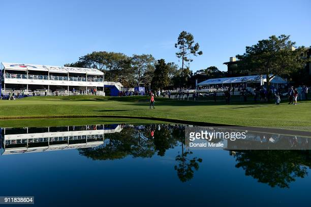 Alex Noren of Sweden walks up the fairway during the sixth playoff on the 18th hole during the final round of the Farmers Insurance Open at Torrey...