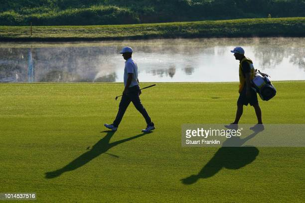 Alex Noren of Sweden walks with caddie Lee Warne during the second round of the 2018 PGA Championship at Bellerive Country Club on August 10 2018 in...