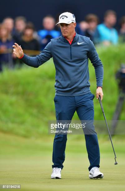 Alex Noren of Sweden waves to the crowd after a birdie on the 1st hole during the first round of the 146th Open Championship at Royal Birkdale on...