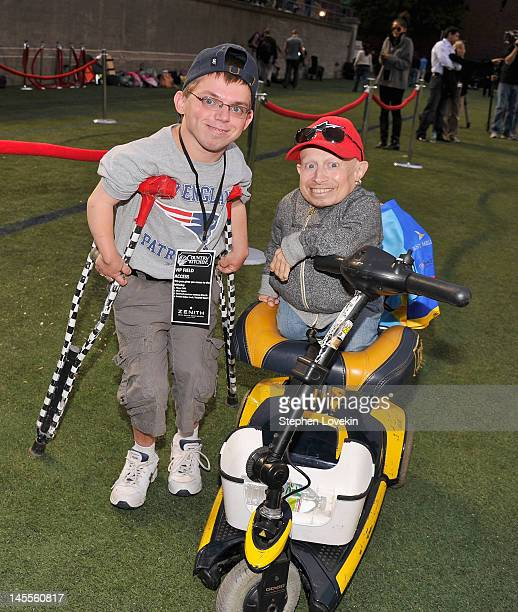 Alex O'Brien and actor Verne Troyer attend the Tom Brady Football Challenge For The Best Buddies Challenge Hyannis Port at Harvard Stadium on June 1...
