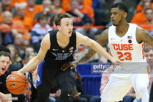 Alex O'Connell of the Duke Blue Devils controls the ball as Frank Howard of the Syracuse Orange defends during the second half at the Carrier Dome on...