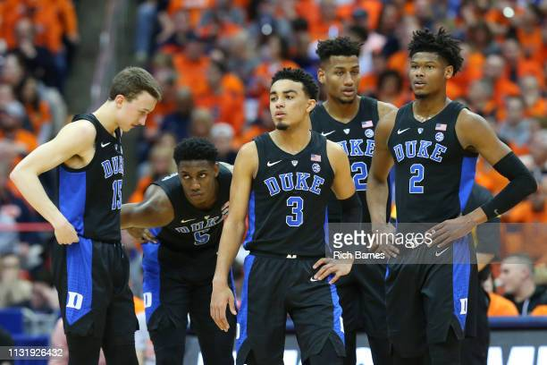 Alex O'Connell RJ Barrett Tre Jones Javin DeLaurier and Cam Reddish of the Duke Blue Devils look on against the Syracuse Orange during the first half...