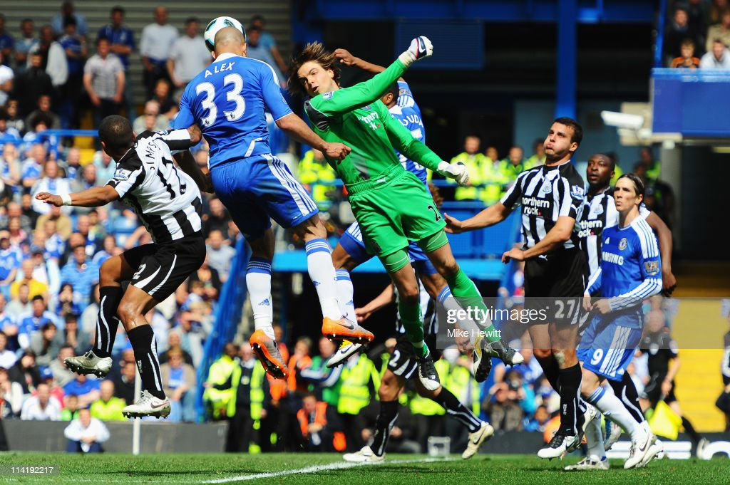 Alex (L) of Chelsea heads his sides second goal as Tim Krul the Newcastle United goalkeeper fails to claim the ball during the Barclays Premier League match between Chelsea and Newcastle United at Stamford Bridge on May 15, 2011 in London, England.