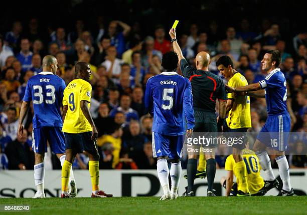 Alex of Chelsea receives a yellow card from referee Tom Henning Ovrebo during the UEFA Champions League Semi Final Second Leg match between Chelsea...